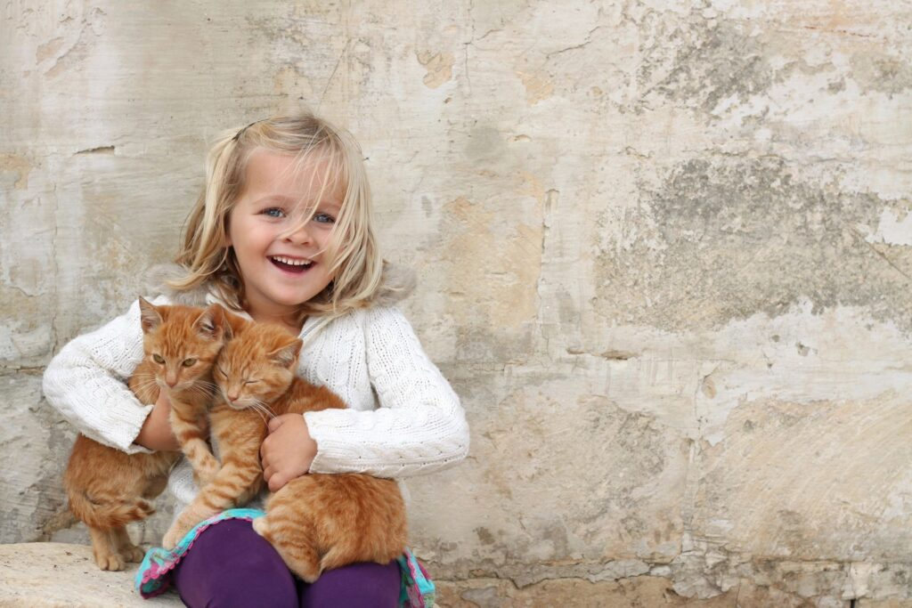 child with cats